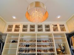 Designer Kerrie Kelly transformed a basic closet into a stunning dressing area, complete with shoe racks, jewelry drawers and elegant chandelier on HGTV.com. When can  I move in?