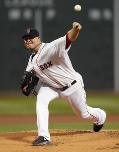 Boston Red Sox's Jon Lester pitches in the first inning of a baseball game against the Baltimore Orioles in Boston, Thursday, Aug. 29, 2013. (AP Photo/Michael Dwyer)