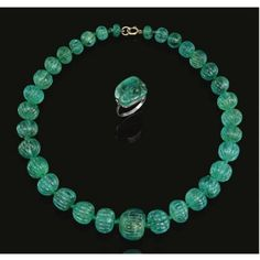 - AN IMPORTANT INDIAN EMERALD BEAD NECKLACE AND A RING, LATE 19TH CENTURY