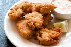Fried Oysters with Chipotle-Lime dipping sauce by Lisa Fain Ingredients for the fried oysters: 1 pint shucked oysters 1 egg, beaten ¼ cup buttermilk 1 cup finely crushed saltines ½ cup cornmeal Salt,. Chip Dip Recipes, Sauce Recipes, Fish Recipes, Seafood Recipes, Appetizer Recipes, Appetizers, Fish Dishes, Seafood Dishes, Soups