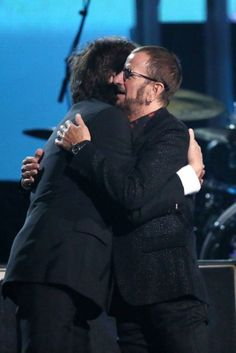 Paul McCartney, left, embraces Ringo Starr at the end of their performance (Grammys, 26 January 2014)