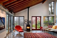 Gorgeous living room with midcentury modern accents looks both stylish and serene