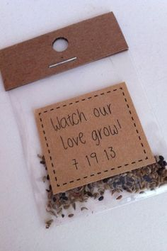 "@Allison - Here's what I'm thinking.....in a small plastic 2x2"" ziplock bag (500 bags cost $4.63 on Amazon), drop in a spoonful of wildflower seeds (a half-lb bag of wildflower seeds costs $13 on Amazon), staple a much less rustic-looking ""Watch our love grow"" DIY-printed ivory card stock label to the top of the bag, and then place on each place setting as favors. Best of all, I'm willing to make 100 of these for you for a total cost of less than $20! Let me know what you think. Your mom :)"