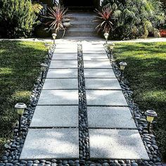 Front yard walkway pavers and river rock