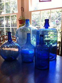 """5 blue """"demijohns"""" in the afternoon light. They are pretty in their own way – Aprill Collection"""