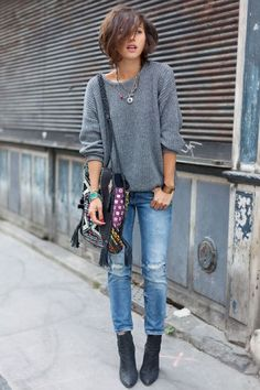 grey sweater. boho bag. booties. distressed jeans. comfy, chic, simple street style.