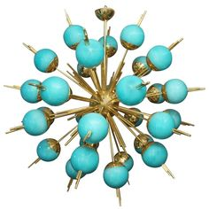 Blue Glass Globes and Brass Sputnik Chandelier | From a unique collection of antique and modern chandeliers and pendants at https://www.1stdibs.com/furniture/lighting/chandeliers-pendant-lights/
