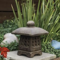This charming lantern features a unique design that fuses together Indonesian and Japanese-inspired traditions. Uniquely crafted of volcanic ash with a stone washed or oxidized iron finish, this indoor/ outdoor lamp will add rustic charm to your decor.