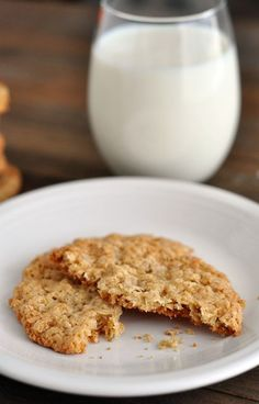 These thin and crispy oatmeal cookies are absolute perfection! Crispy, buttery, and completely addictive - I dare you to eat just one! #thinandcrispycookie #oatmealcookie #cookieperfection #cookie #yum #dessert #melskitchencafe