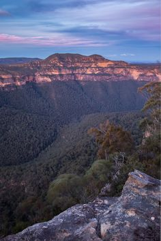 Mt Banks - The wind picks up, the clouds begin to roll in, and the small ledge my tripod is perched on begins to feel exposed and isolated as darkness fast approaches.  Looking North across the Grose Valley towards Mt Banks 1,049 m (3,442 ft) in the Blue Mountains.  The Greater Blue Mountains World Heritage Area covers 10,300 square kilometres (4,000 sq mi) of wilderness.   Blue Mountains National Park, New South Wales, Australia  <a…