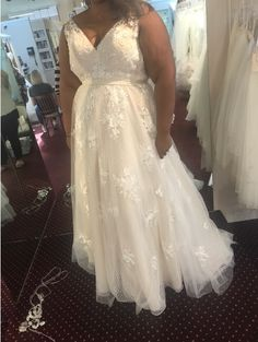 This sleeveless plus size wedding dress with v-neck line can be made in any measurements.  We make csutom #weddingdresses for all sizes.  We also make #replicas of desigenr #dresses for #brides who can not afford the original.  Our version will have the same style but cost way less thatn a couture design.  Get pricing and more details when you contact us directly on our main website.