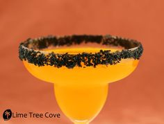 Hallow-Rita - Halloween Margarita (Serves 1): Ingredients needed: 4oz Newman's Own Limeade 2oz. Orange Juice 2oz Tequila Splash Triple Sec Fresh squeezed lime and lime slices Ice Natural Orange Colored Sugar from the Mischief Maker Package Lime Tree Cove Hawaiian Black Lava Salt