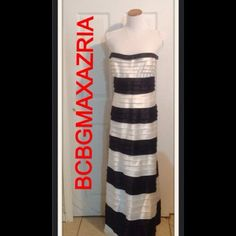 BCBGMAXAZRIA Gown Black and white sateen strapless fabric tiered gown.  The gown is made up of layers of fabric that can be cut off to be customized to your height or made from a long gown to a short dress.  The back and sides have wiring so that it can hold it's shape.  Hidden Zipper in the back.  It is a size 12 but runs small.  Fits a size 8-10.  The measurements are: 38 inches on top. 34 inches at the waist. 44 inches at the hips and 48 inches long.  Worn once to an event. Has been dry…