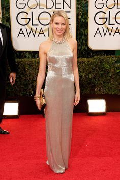 Naomi Watts oozed Hollywood glam in a glittering champagne Tom Ford halter dress, accessorized with delicate, matching gold accessories.