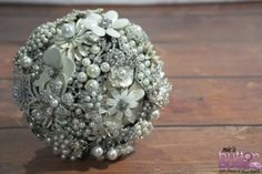 This is one of my favourites... I would be the luckiest bride in the world to carry this bouquet with me to New Zealand for my wedding.  I have admired these bouquets from #nicsbuttonbuds and @nicsbuttonbuds for months!  Please choose me and I'll be on top of the world!  Literally!  Wedding Brooch Bouquet  Nic's Button Buds - www.mybuttonbouqu... For the bride that dares to be different Button Bouquets, Brooch Bouquets, Mixed Media Bouquets & other wedding accessories.