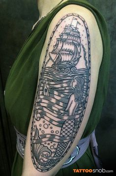 This line work tattoo is seriously cool!   »» »» Woodcut mermaid tattoo by Duke Riley