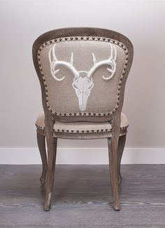 Cabin chic - we're loving the 3-d loaded embroidery on this stag chair.