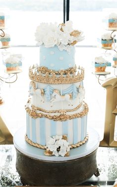 Pale blue and gold carousel cake by Lady K's Bake Shop