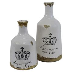 Set of 2 weathered ceramic vases with a crown motif.     Product: Small and large vaseConstruction Material: Ce...