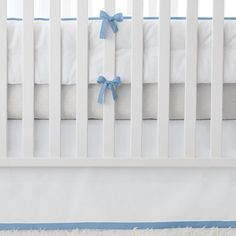 NURSERY BASICS - CHAMBRAY  Chambray is the color that plays nice with others. Punch it up with brights or keep it serene with lazy shades. Everything works with this true blue. The bumpers and skirts are crafted with classic white twill and just the right amount of color and detail. Add any of our patterned crib sheets to create the look (or looks) you love.