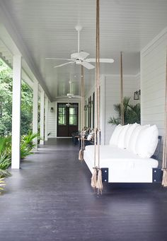 A beautiful bungalow home was designed for family living by Heather A Wilson, Architect along with designer Jen Langston in Mount Pleasant, South Carolina. Home Porch, House With Porch, Porch Bed, Indoor Outdoor Living, Outdoor Rooms, Outdoor Daybed, Outdoor Swing Chair, Outdoor Fans, Outdoor Swings