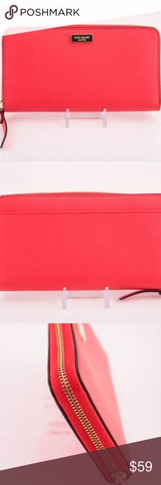 """Kate Spade Newbury Lane Neda Clutch Wallet Coral Kate Spade zip around wallet is accented with the Kate Spade name plate on the front and features a full length slip pocket on the back. Top stitch detailing throughout. The interior is Rosegold leather with coordinating cream fabric. It features a center zippered compartment, 12 card slots and multiple full length bill compartments. Overall measurements of approximately 8"""" (L) x 4"""" (H) x 1"""" (W). Coral Flamingo kate spade Bags Wallets"""