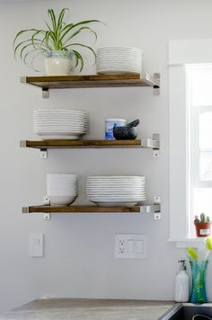 Open Shelving: We're loving open shelving in the kitchen and are definitely down to DIY our own. All you need are brackets from IKEA and the perfect piece of wood from your hardware store. (via Lemon Thistle)