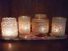 1. Cover mason jars with lace 2. Spray frosting paint over lace 3. Remove lace 4. Place candle inside and enjoy - pretty diy decor! by jeneane.morello
