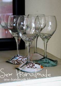 My step-mom uses these paper wine glass cozies / coasters . She loves them to help with condensation on the glass and also to help guests re...