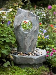 Grey stone monolith water feature with lights. Makes an attractive focal point.