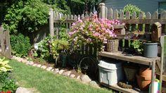 pinterest garden ideas | POTTING BENCH AND HANGING BASKET