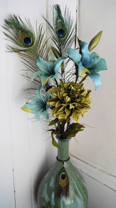 Flower arrangement with peacock feathers! <3 Beautiful home decor!