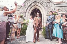 Confetti at country church wedding in Dorset. Photography by one thousand words wedding photographers