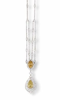 A COLOURED DIAMOND AND DIAMOND PENDENT NECKLACE    Set with a pear-shaped fancy yellow diamond weighing 1.56 carats within a two-row diamond surround with a brilliant-cut diamond suspended by a marquise-cut fancy deep brown-yellow weighing 1.20 carats within a diamond surround enhanced by brilliant-cut diamond spacers to a diamond collet neckchain, mounted in platinum, 45.5 cm long
