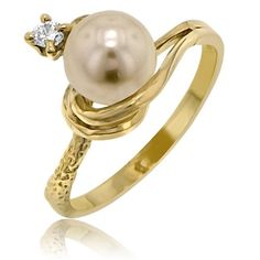 Ladies Freshwater Pearl & Diamond Engagement Ring - Here's a uniquely designed Ladies Freshwater Pearl & Diamond Engagement Ring stamped in 14k Yellow Gold featuring a pristine Round Cultured White Pearl at the top of the ring along with a White Round Brilliant accent side stone atop of the ring within a prong setting. The Ladies Freshwater Pearl ring's total gem weight is equal to 2.4 Grams. #unusualengagementrings