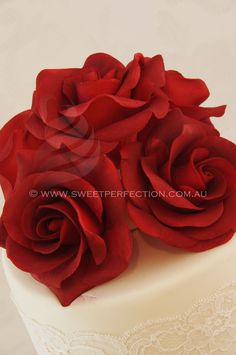 Deep red sugar rose custom wedding cake topper made by Sweet Perfection.
