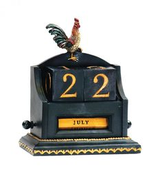 Black and copper date keeper with a rooster motif. Product: Date keeperConstruction Material: Composite woodColor: Copper and black Dimensions: 6 H x 3 W Cleaning and Care: Wipe with damp cloth Apple Kitchen Decor, Rooster Kitchen Decor, Rooster Decor, Kitchen Themes, Country Kitchen, Country Life, Kitchen Ideas, Farmers Table, Rooster Statue