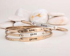 mixed metal stackable name bangles for moms or gramdothers. Add your children's names, nickname, birthdate, anniversary date, or word on these personalized at www.nelleandlizzy.com Nelle and Lizzy