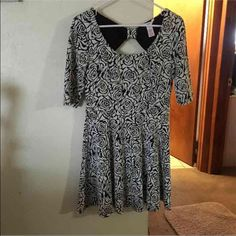 White & Black Flower Dress True to size. Worn once.  Very pretty winter dress for any occasion!  No wears, tears, stains! Pretty much new! Candie's Dresses Midi