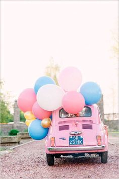 Want to arrive in style? We just love this pink Fiat 500 decorated with pastel coloured balloons! The perfect choice for a bright summer wedding www.wed2b.co.uk