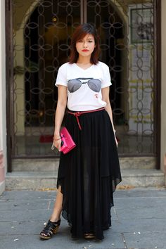 Catherine Tan, branding executive. Zara skirt and shoes, thrift-store top, Pull and Bear belt, Rolex watch. More SceneStyle