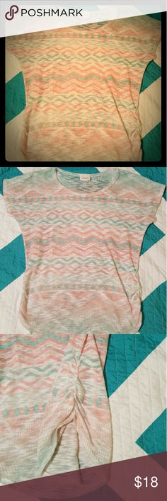 Tribal T-shirt with ruching on the sides Cute tribal shirt with ruching down the sides. Thinner material so its great for summer or spring. Very comfortable. Teal and Coral designs. Size Large. Lashes Tops