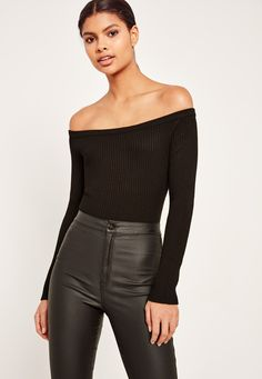 Bardot isn't just a trend anymore, it's a way of life. Bare those shoulders in this knitted bodysuit in a jet black hue and long sleeves.