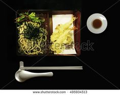 Famous Japanese food named Tempura Soba Set on dark background.