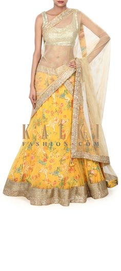 Buy Online from the link below. We ship worldwide (Free Shipping over US$100) Price- $469 Click Anywhere to Tag http://www.kalkifashion.com/yellow-printed-lehenga-adorn-in-zari-border-only-on-kalki.html