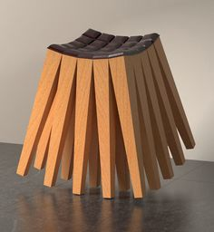 """Have a seat! Aminimal's innovative Calibration Stool and its Lounge counterpart, respectively evocative of a porcupine and spiny caterpillar, are made up of multiple wooden legs to create what they call a """"3D rocking chair""""."""