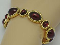 MAZER Vintage Red Cabochon Glass Gold Plated Bracelet Classy  and elegant vintage MAZER bracelet.  The bracelet is designed with  red glass oval