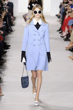 This season, Kors went back to that '70s era he loves so much, the one where his icon was by then known as Jackie O, wore oversized sunglasses and Italian loafers (which are turning into the shoe of the moment). Yet Kors messed around with traditional colors, giving preppy green some citrus oomph, pairing gold brocade with camel and letting lavender live head-to-toe without an ounce of princess-ness in a beautiful car coat, turtleneck and feathered mini.