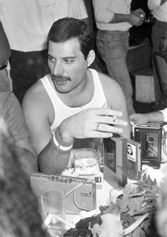 Freddie Mercury. Look at all the tape recorders on the table!