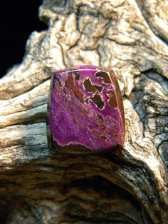 "Sugilite: the ""love stone"".  provides spiritual protection and purification, relieves despair, releases old patterns that prevent a healthy relationship, invites new love into one's life.  Creates a ""shield"" of light and cleanses the auric field."